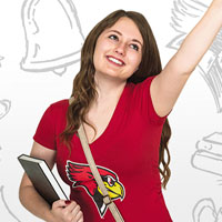 ISU student smiling with books in arm.