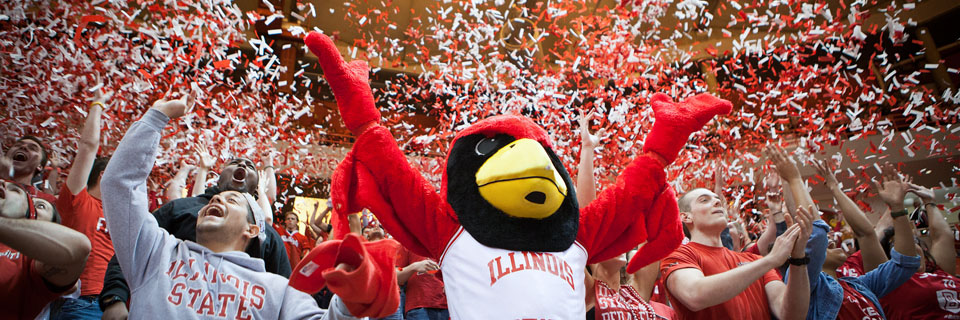 Students celebrating with Reggie Redbird as confetti falls to the ground.