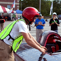 Student prepares to test out his solar powered car.