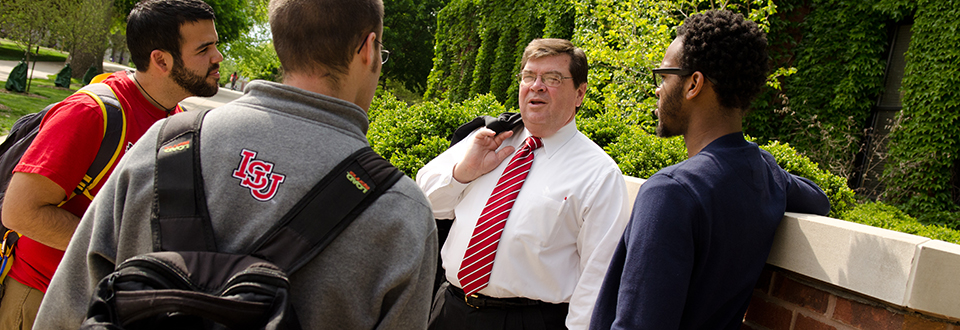 Dr. Dietz talking to students on the quad